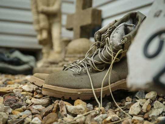 Casey Byers' boots at his parents' home in Le Mars, Iowa, May 8, 2018.