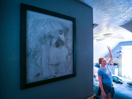 Hailey Byers with her artwork in her home in Le Mars, Iowa, May 8, 2018.