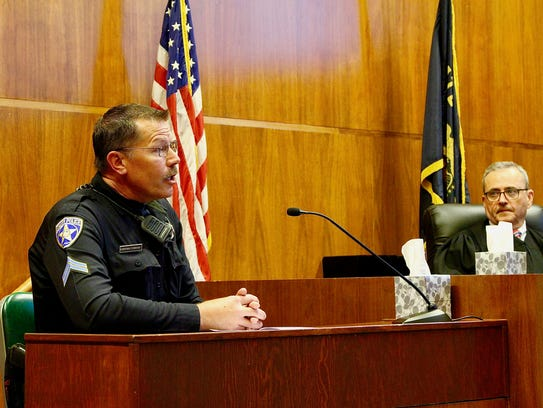 Salem Police Cpl. Andrew Connolly reads a victim statement