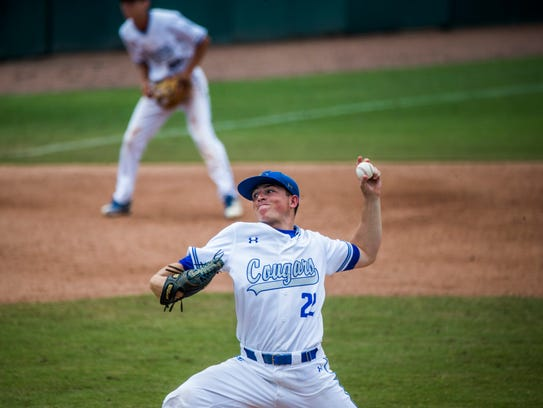 Barron Collier senior Nick Denove pitches against Merritt