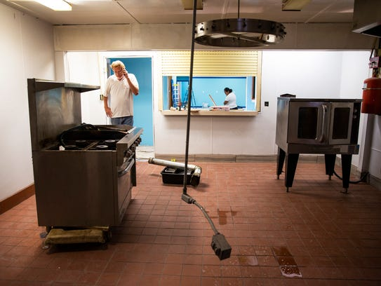 John Madsen speaks to a contractor over the phone while overseeing renovations at American Legion Post 135 in East Naples on Thursday, May 31, 2018. The Hardee R. Mills Post was damaged by Hurricane Irma.