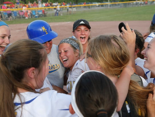 Maine Endwell's softball team celebrates winning the