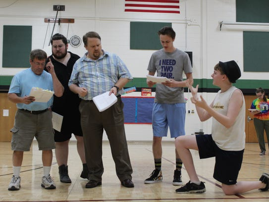 "Randy Kellner, from left, Nick Lamers, Rob Konitzer, Kennan Deshambo, Aidyn Reetz and Molly Schlaak rehearse a scene from ""Spamalot,"" opening June 20 by the Kaukauna Community Players."