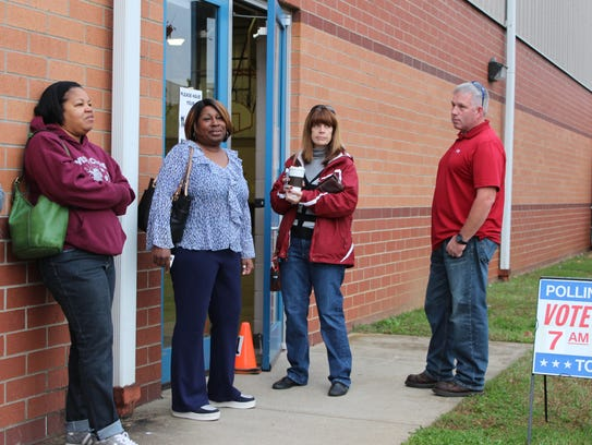 Voters line up outside of Hazelwood before doors open