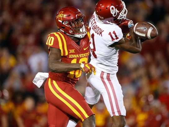 Iowa State's Brian Peavy (10) breaks up a pass intended