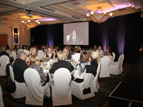 At a Fashion Night in Black & White, attendees are