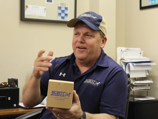 Paul Coley holds a Scent Evidence K9 scent kit, which