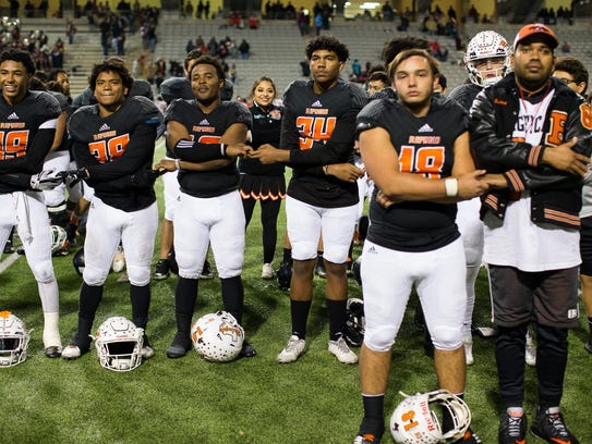 Refugio players stand for their school song after winning the Class 2A D-I State Semifinal game against San Augustine on Dec. 14 in Cypress.