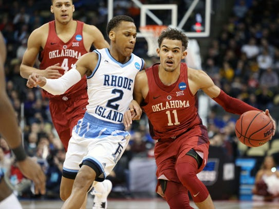 Oklahoma Sooners guard Trae Young (11) drives against