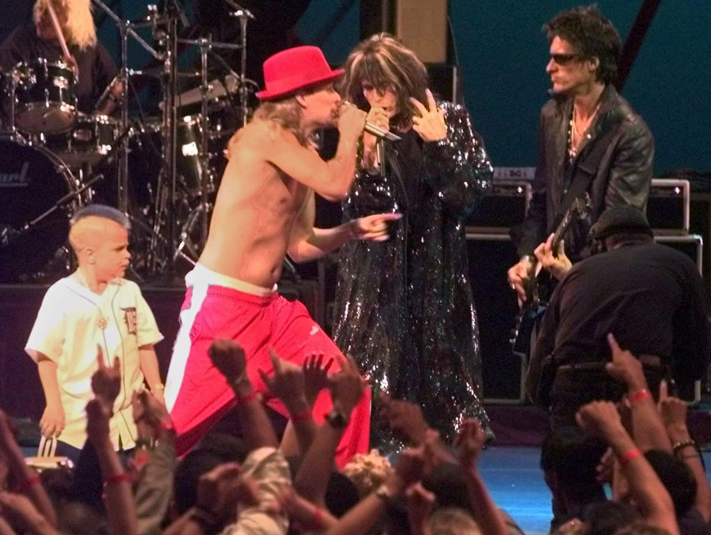 Kid Rock, center, and Joe C, left, perform during the