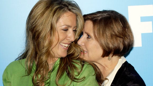 Joely Fisher, left, and the late Carrie Fisher goof