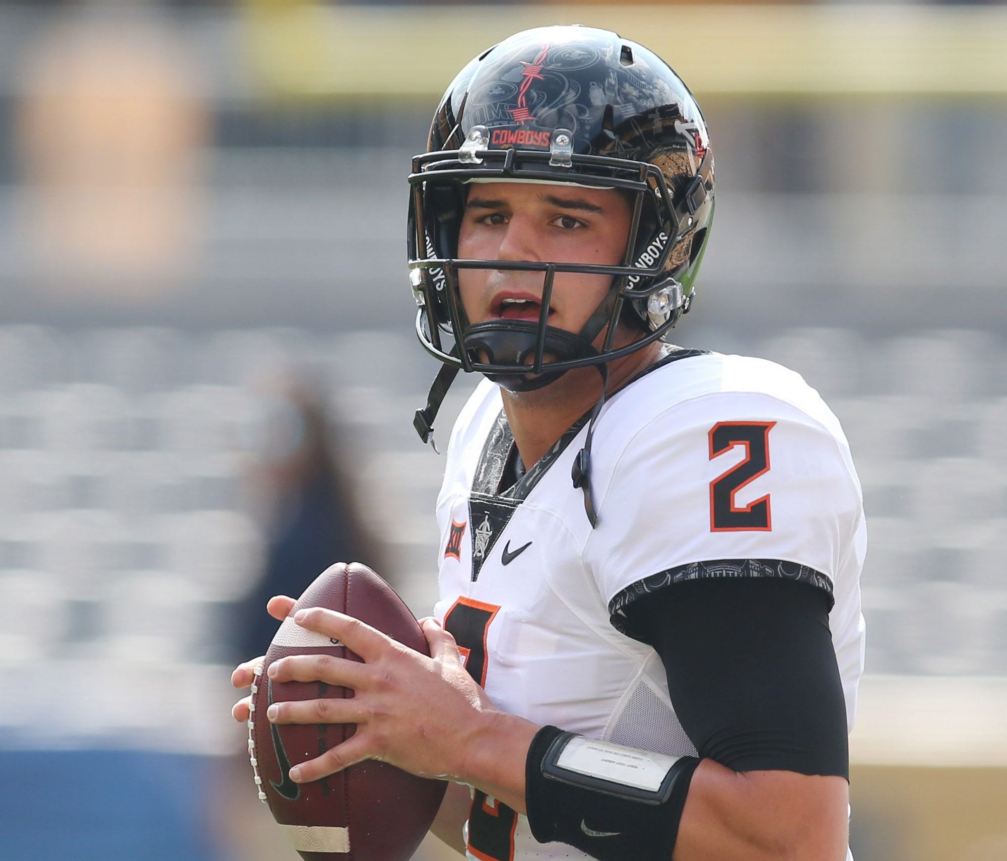 Oklahoma State Cowboys quarterback Mason Rudolph (2) warms up before playing the Pittsburgh Panthers against at Heinz Field.