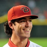 Jul 20, 2015: First overall pick in the 2015 MLB draft Dansby Swanson looks on after signing with the Arizona Diamondbacks  at Chase Field.