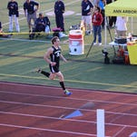 Pinckney's Emmett Smrcka won the 800-meter open and was part of the winning distance-medley relay team at the Golden Triangle Invitational on May 6.