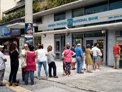 Greeks line adult in front of a National Bank to use