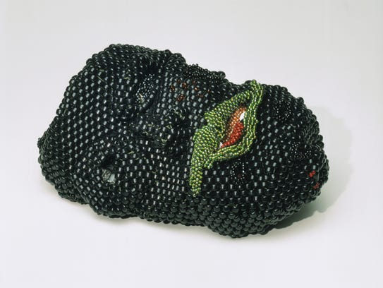 Celebrated glass artist Paul Stankard says Joyce J. Scott delivers an  'unflinching commentary on violence and race.'  Scott's work 'Rodney King's Head Was Squashed Like a Watermelon' is a 1991 sculpture in beads and thread. It is in the collection of the Philadelphia Museum of Art, purchased with funds contributed by the Women's Committee and the Craft Show Committee of the Philadelphia Museum of Art in 1995.