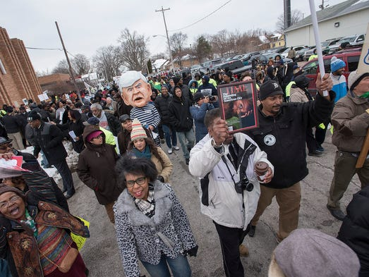 Hundreds of Flint residents start a march outside Metropolitan