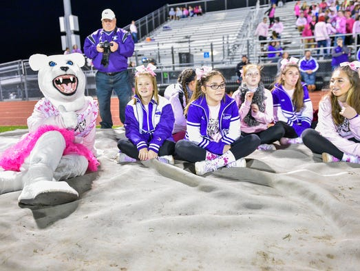 Northern York's cheer squad sit and relax while watching
