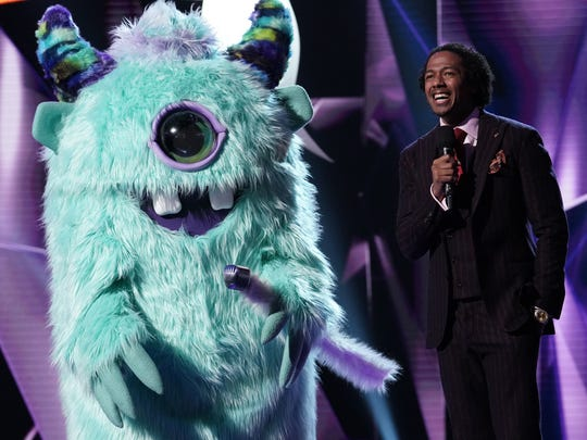 "A celebrity in the ""Monster"" costume and host Nick"