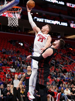 Detroit Pistons forward Blake Griffin (23) goes up for a shot against Portland Trail Blazers center Jusuf Nurkic (27) during the second quarter at Little Caesars Arena, Monday, Feb. 5, 2018.