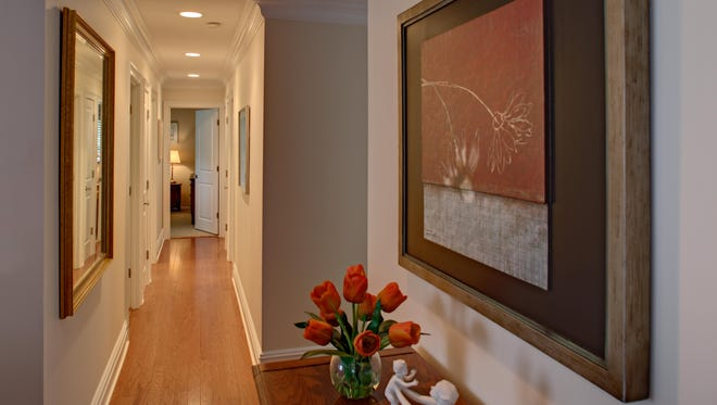 Recessed lighting not only warmly illuminates the hall, but is also designed to create path lighting for senior citizens and guests.