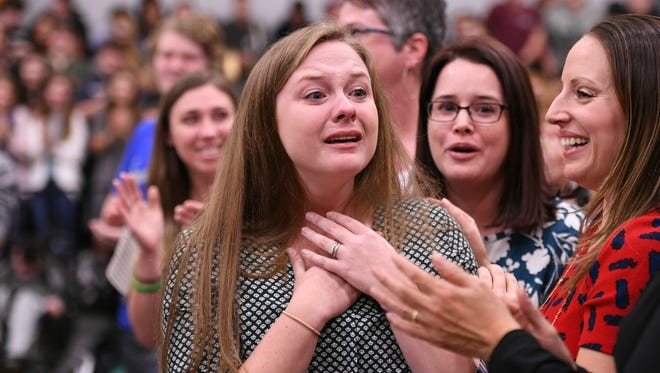 As colleagues and students fill the gym with deafening cheers, a visibly emotional Paula Franklin begins to make her way to the front of the assembly. Franklin was surprised with the Milken Educator Award.