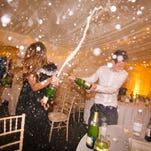 Partygoers spray Champagne