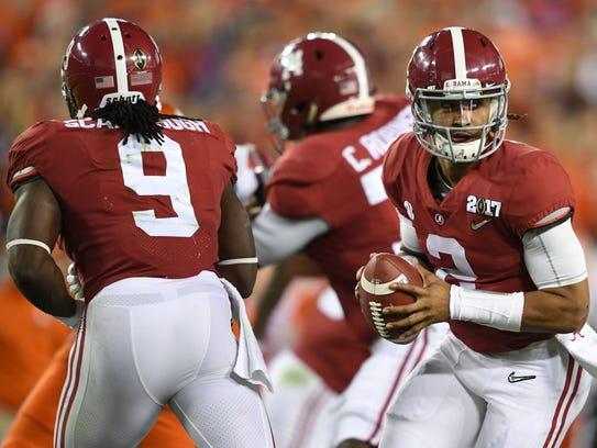 Alabama quarterback Jalen Hurts (2) looks to lead the