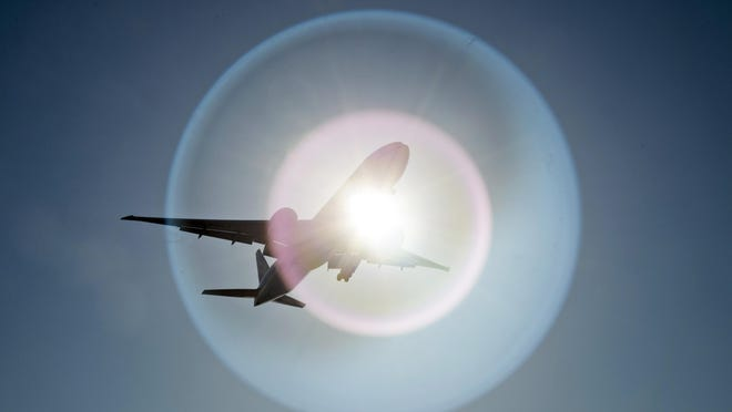 A Southern China Airlines flight from Guangzhou, China causes a light flare on the camera lens as it flies past the sun as it arrives at Vancouver International Airport in Richmond, B.C. March 18. THE CANADIAN PRESS/Jonathan Hayward