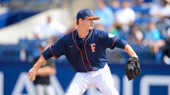 Cal State Fullerton freshman pitcher Chad Hockin delivers in a game against Long Beach State earlier this season in Fullerton, Calif.