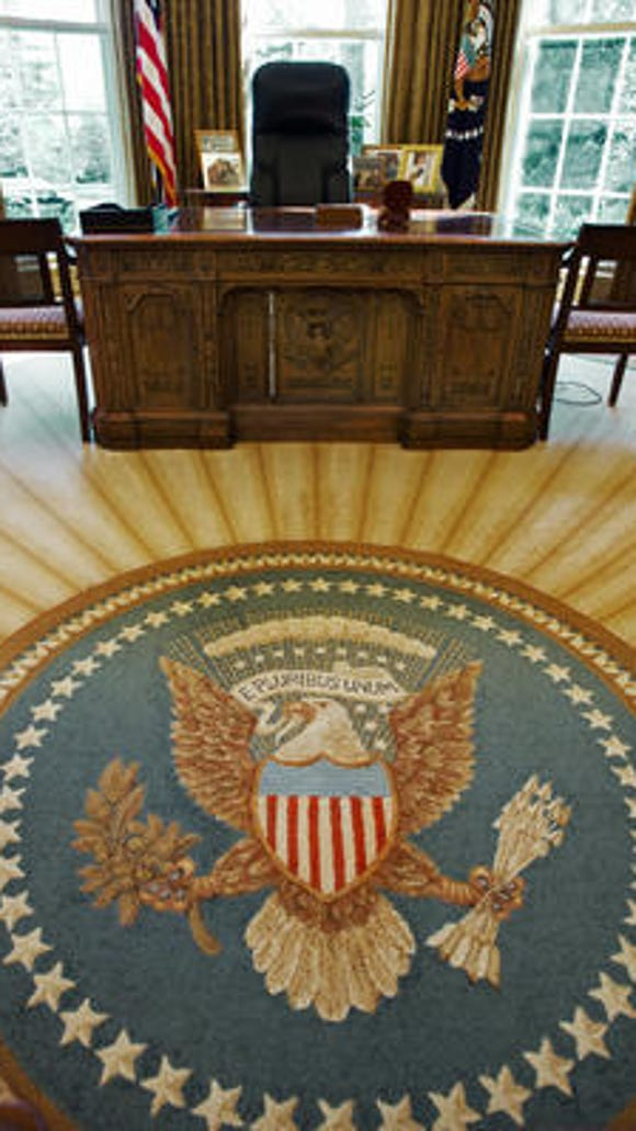 The Great Seal of the United States, which is woven into the carpet, is seen inside the Oval Office of the White House February 29, 2008 in Washington, DC.