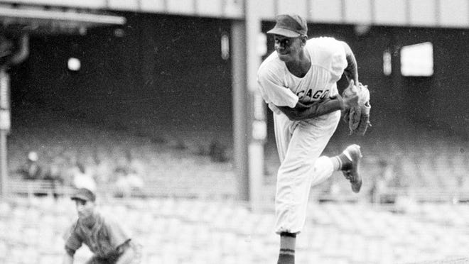 In this Aug. 17, 1961, file photo, Satchel Paige is shown in action during the Negro American League All-Star Game at Yankee Stadium.