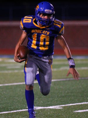 Bloomfield's Rogelio Gonzales carries the ball against Hope Christian during Friday's game at Bobcat Stadium in Bloomfield.