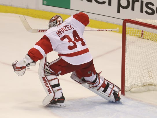 Red Wings goalie Petr Mrazek celebrates the 6-5 shoot-out