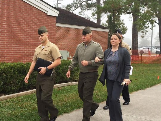 Gunnery Sgt. Joseph Felix, center, walks into the courtroom at Camp Lejeune in North Carolina with his wife and lawyers during his trial in November 2017.