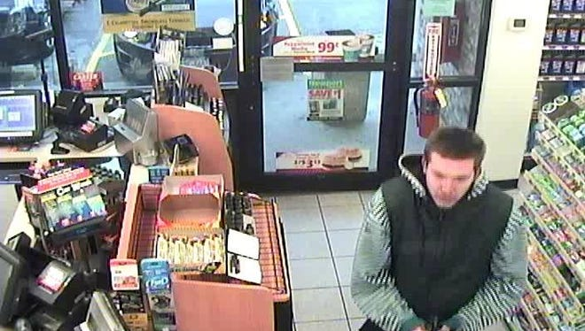 Police are searching for this man and another suspect in connection with a robbery that took place Saturday, Nov. 18 at GT Vapor, N112W15800 Mequon Road. The two stopped at a gas station nearby before the robbery.
