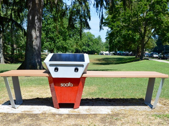 A new Soofa Bench installed outside the Huguenot Children's Library in New Rochelle.