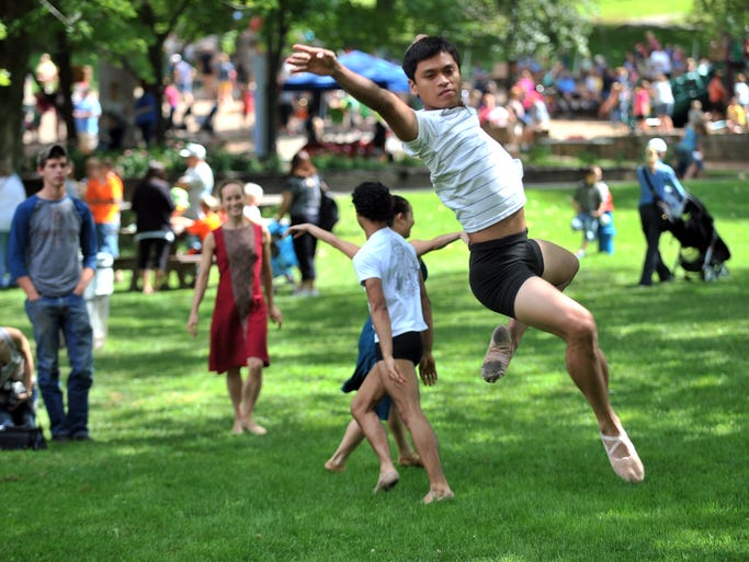 Jared Tan jumps in the air Thursday morning, July 24, 2014, at Rising Park in Lancaster. Tan and other Wabi Sabi dancers from the Atlanta Ballet Company performed at the park as part of the Lancaster Festival's Rising Park Day.
