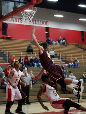 Cooper guard Chris McNeil draws the foul as he scores.