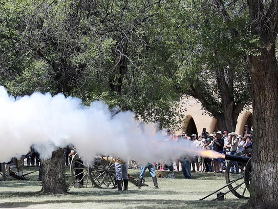 Cannon fire always draws a crowd at the annual Fort