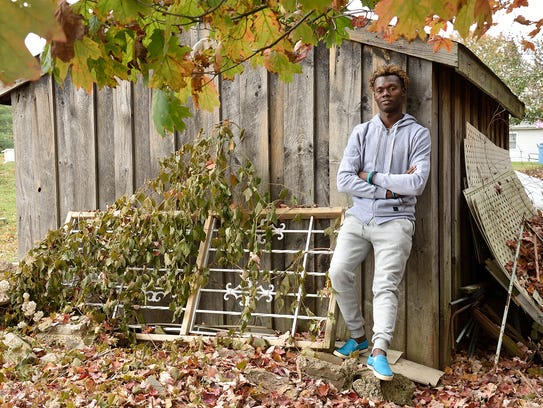 Haitian immigrant Jean Radyn Piard in the backyard