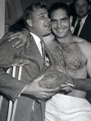 Lions quarterback Bobby Layne, left, who broke his