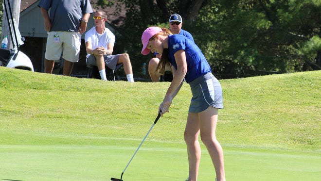McNairy Central's Emily Hamm taps in her putt on her final hole of the TSSAA Large Division golf championships.