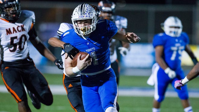LA JOLLA, December 17, 2016   Oakland McClymonds at La Jolla Country Day in the Division 5-A high school football CIF State Championships. La Jolla Country Day quarterback Braxton Burmeister breaks tackles en route to a first quarter touchdown rush for the Torreys. Chadd Cady for The San Diego Union-Tribune / Bay Area News Group