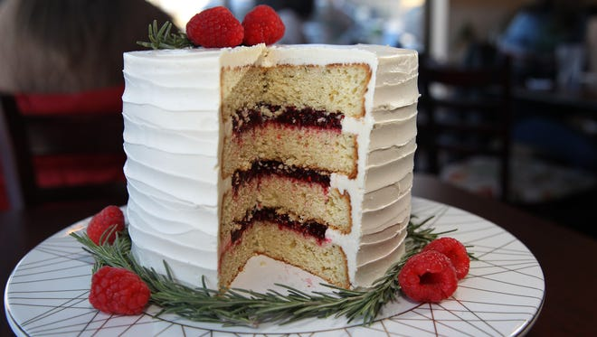 Lemon rosemary layer cake is one of the cakes sold by the slice at Miss Molly's Cafe & Pastry Shop, 9201 W. Center St.