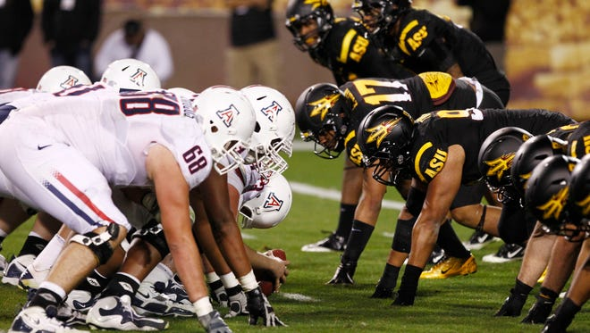 Arizona and ASU line up at the line of scrimmage during the 2011 Territorial Cup game in Tempe.
