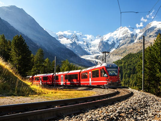 swiss train in the alps mountains in switzerland around ospizio bernina