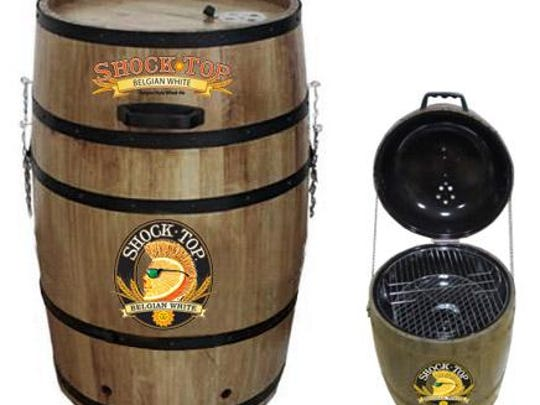 Wooden barrel-shaped charcoal grills with the Shock Top logo at the front can catch on fire, posing a fire hazard.