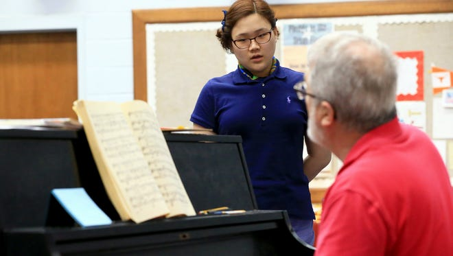 Katherine Jeoung performs a song while practicing as she practices with choir instructor Kim Bryce on Tuesday, Jan. 24, 2017, at Ray High School in Corpus Christi.