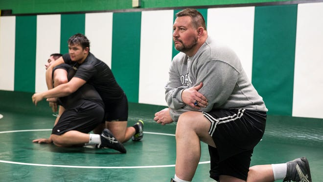 Trent McCormick works with his wrestlers for the final set of practices on Feb. 15 at Yorktown High School. Saturday's state finals at Bankers Life Fieldhouse on Feb. 17 will be the final meet of McCormick's 30 year coaching career.